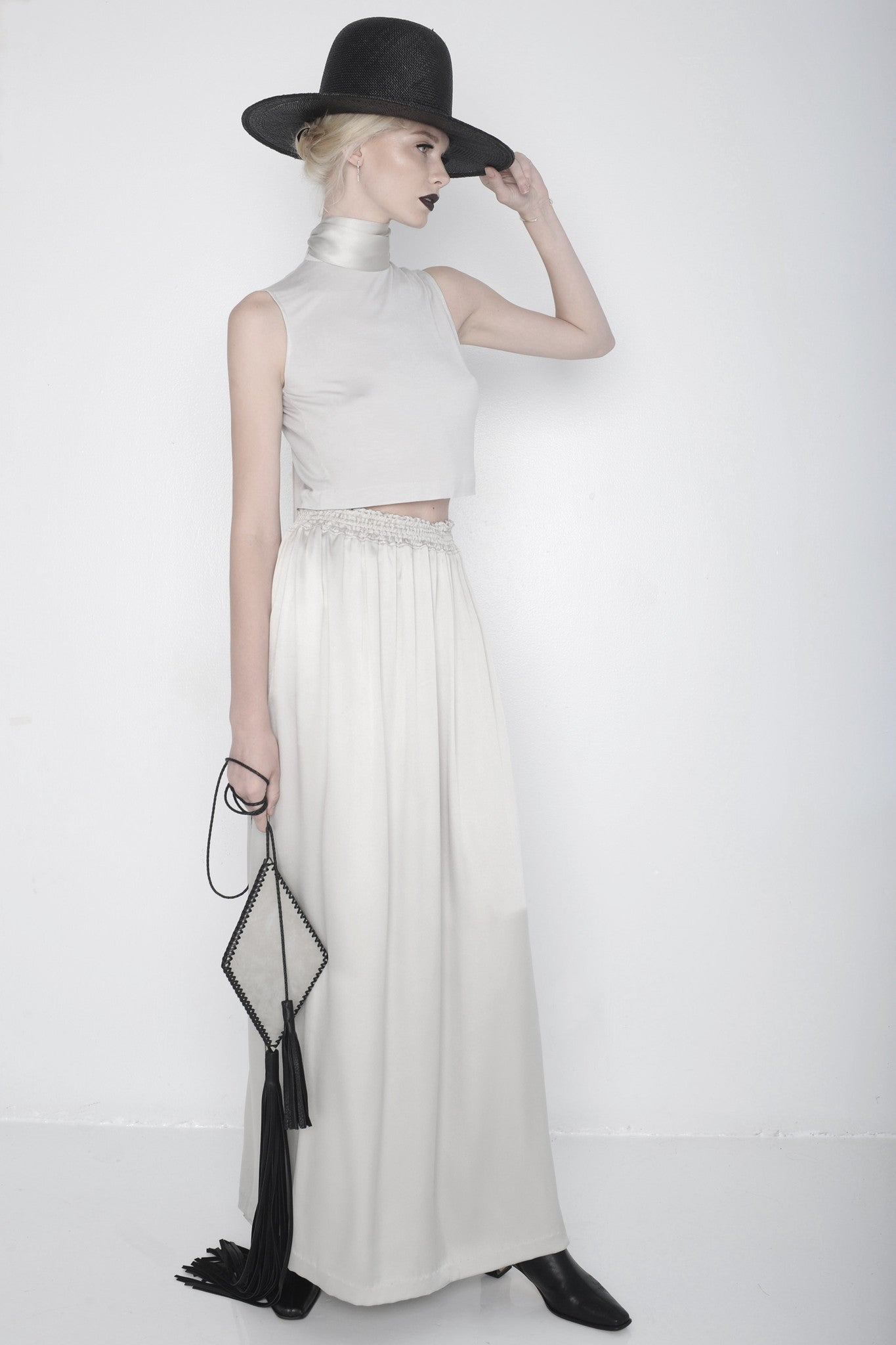 Daria Z IMG Model Wendy Nichol Clothing Designer Ready to Wear Fashion Runway Show SS16 Guardians of Light Grey Line Silver Silk Satin Mock Turtle Neck Sleeveless Crop Top Shirt Silver Satin Long High Waist Waisted Skirt side slit Black Straw Wide brim Hat Wide Silver Silk Satin Tie Choker Triangle Pyramid Sculpture Handmade in NYC Custom Fabric Tailoring Made to Order