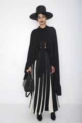Gizele O model Fashion Runway Show Black Leather Dr Doc Doctor Classic Handbag Bag Wendy Nichol Designer Handbag Handmade in NYC New York City Cross body Strap Detachable adjustable large handles braided structured interior pockets zip zipper large Fringe tassel High Quality Leather