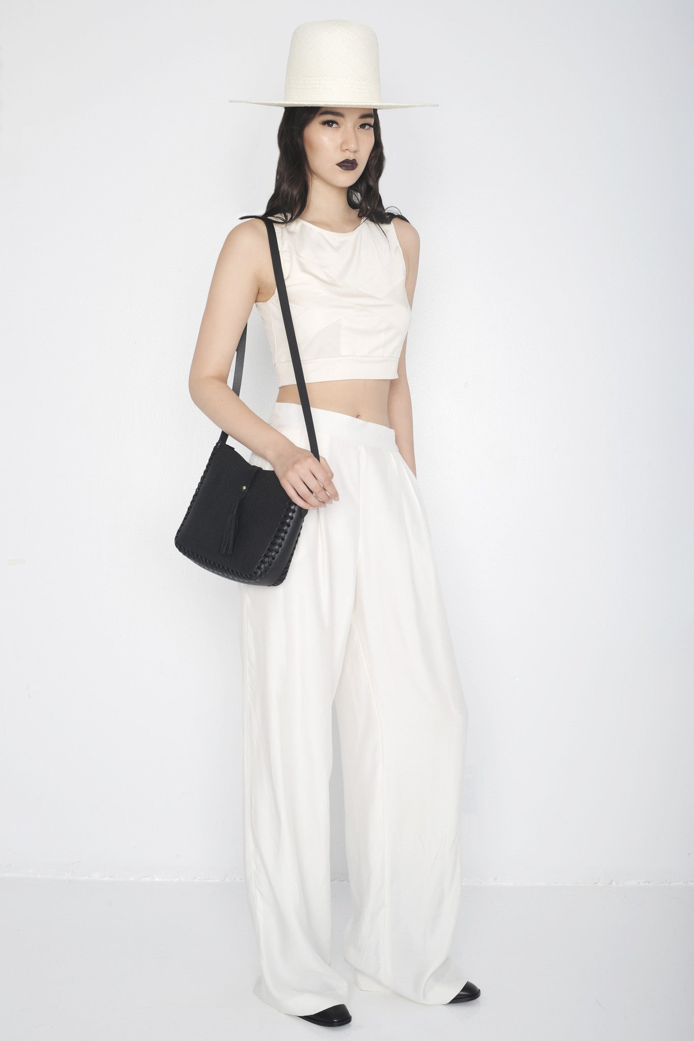 Mona IMG Model Wendy Nichol Clothing Designer Ready to Wear Fashion Runway show SS16 Guardians of Light High Noon Silk Mesh Cross Crop Top Sleeveless Cream White Silk Pleated Wide Leg Pants High Waisted Handmade in NYC  Custom Tailoring Made to Measure Order