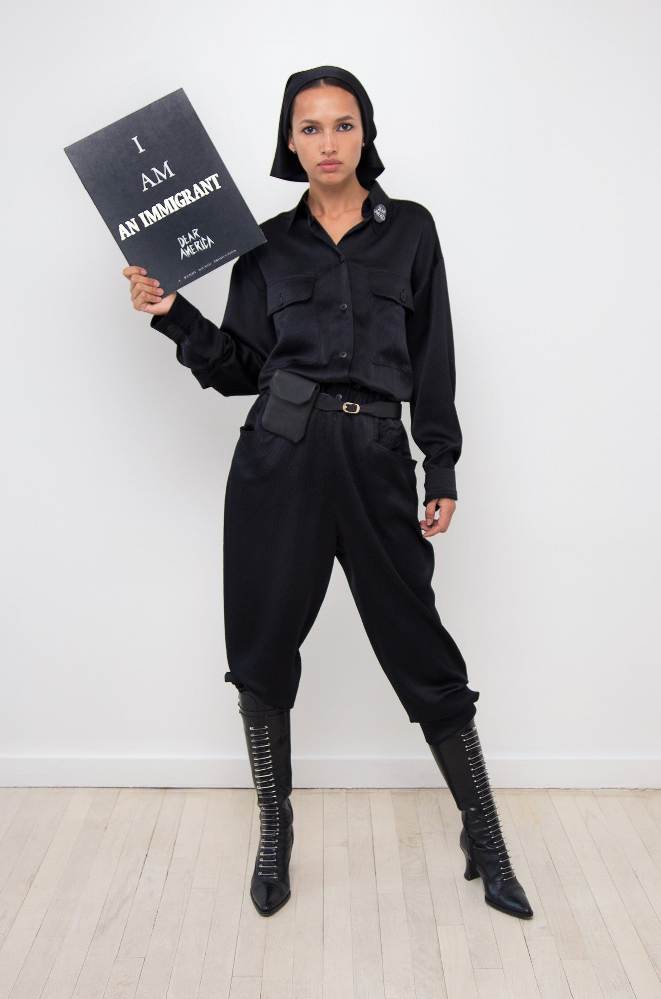 Camila IMG Model Wendy Nichol AW17 Clothing Fashion Anti Fascist Runway Show Dear America Handmade in NYC New York City Protest March I AM Long Sleeve Marching Jumper Silk button collar pockets GI Jane Combat Military Black Uniform Jumpsuit Jumper Aviator Top Gun