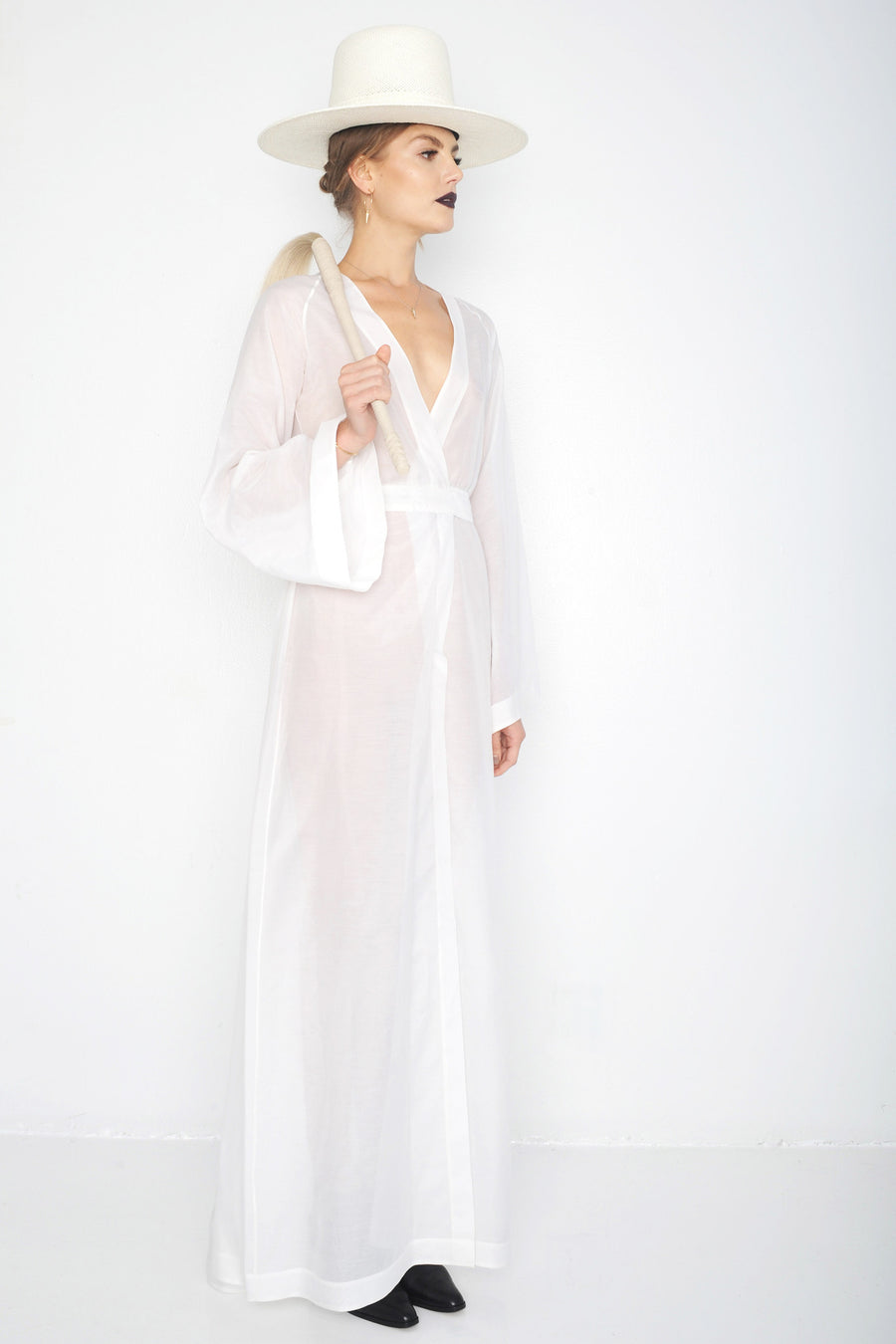 Svetlana IMG Model Wendy Nichol Clothing Designer Handmade in NYC New York City Made to Order Custom Tailoring Made to Measure Bespoke Ready to Wear Fashion Runway Show SS16 Guardians of Light Golden Hour Wrap Dress Silk Sheer Transparent Kimono Deep V Plunge Open cut out Diamond Back Bell Sleeves White Witch Wizard Wedding Bride Magic Magical Summer White Straw Wide Brim Hat