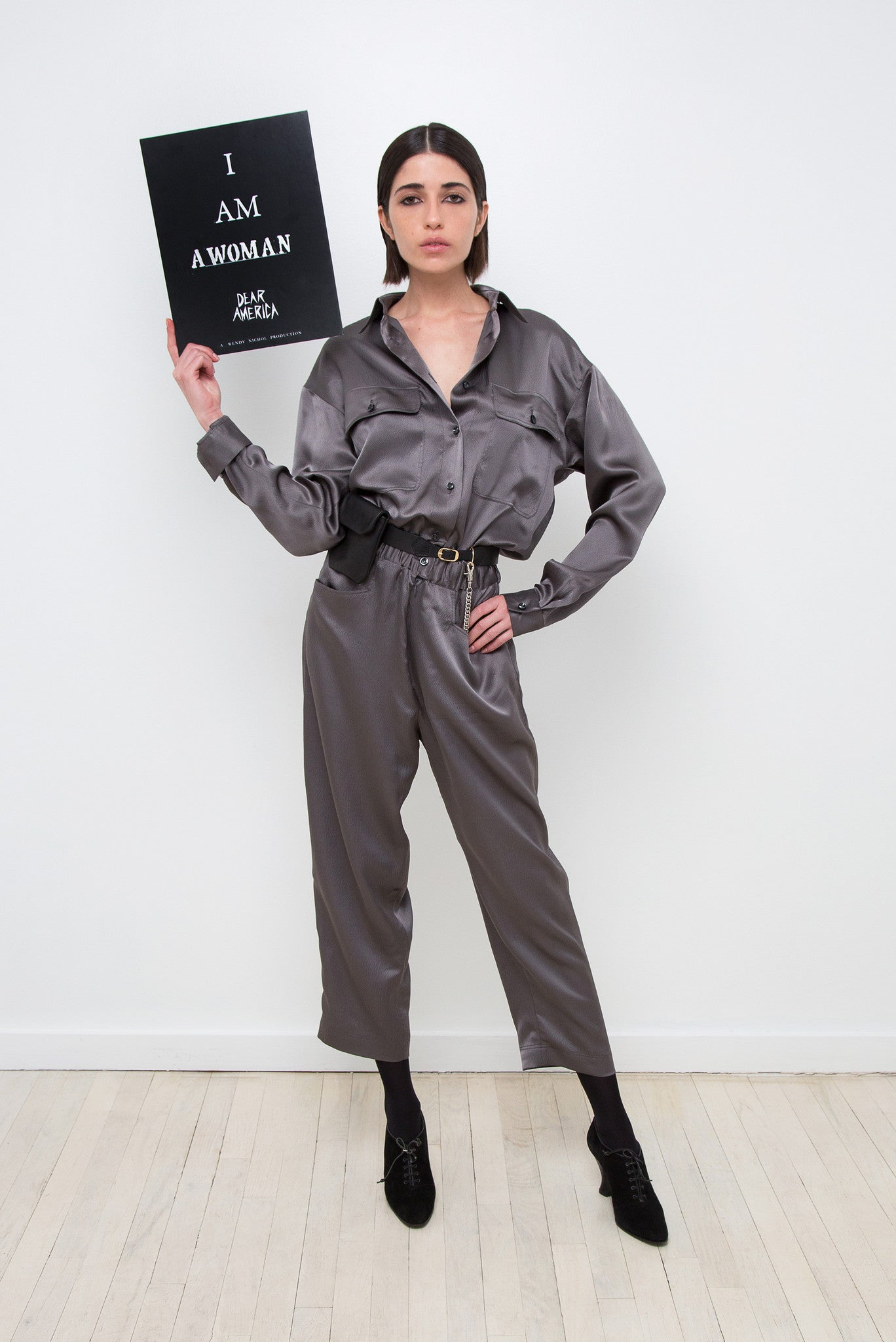 Vanessa Moreira IMG Model Wendy Nichol AW17 Clothing Fashion Anti Fascist Runway Show Dear America Handmade in NYC New York City Protest March I AM Long Sleeve Marching Jumper Silk Grey Gray Silver Purple Lilac button collar pockets GI Jane Combat Military Black Uniform Jumpsuit Jumper Aviator Top Gun