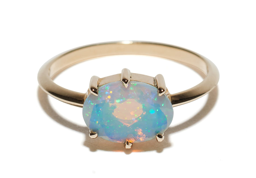 6 Six Prong setting Horizontal Oval Faceted Opal Ring Wendy Nichol Fine Jewelry Designer solid 14k Gold Yellow Rose White Handmade in NYC New York City Faceted Opal Stone Knife Edge Band Orbit Galaxy Cosmic Libra October Birthday Birthstone