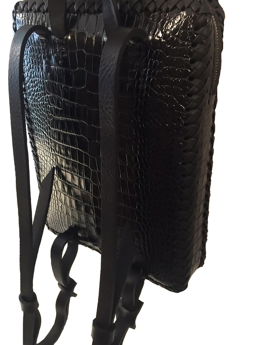 Black Shiny Reflective Embossed Croc Crocodile Alligator Cowhide Leather Folio Backpack Wendy Nichol Handbag Purse Designer Handmade in NYC New York City Rectangle Square Braided Structured Structural French Work School Backpack Fringe Tassel Adjustable Straps Zip Zipper High Quality Leather