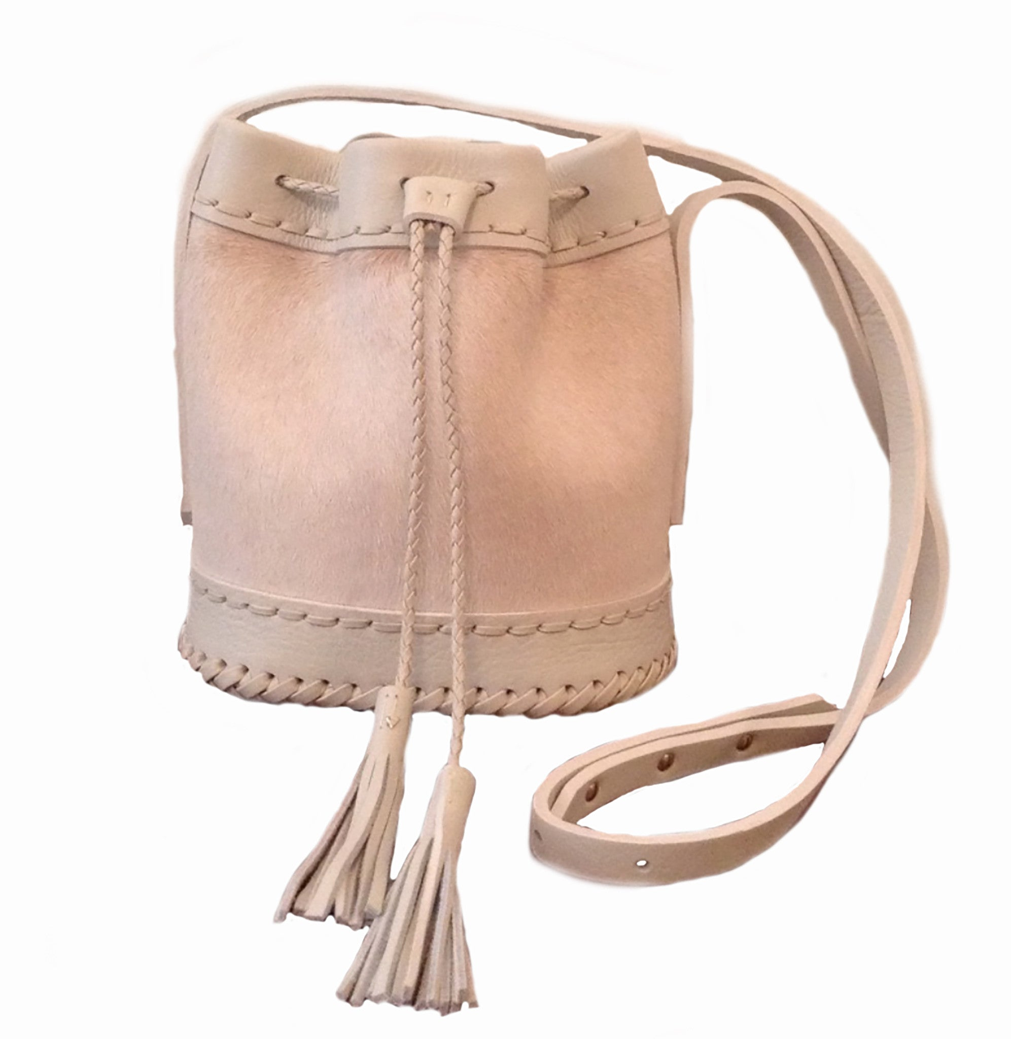 Summer Blush light Pink Cream Off White Leather cowhide Pony Cow Fur Small carriage Bag Wendy Nichol Luxury Handbag purse Designer handmade in NYC New York City bucket Drawstring Draw String Pouch Small fringe tassel Mini cross body adjustable durable strap High Quality Leather