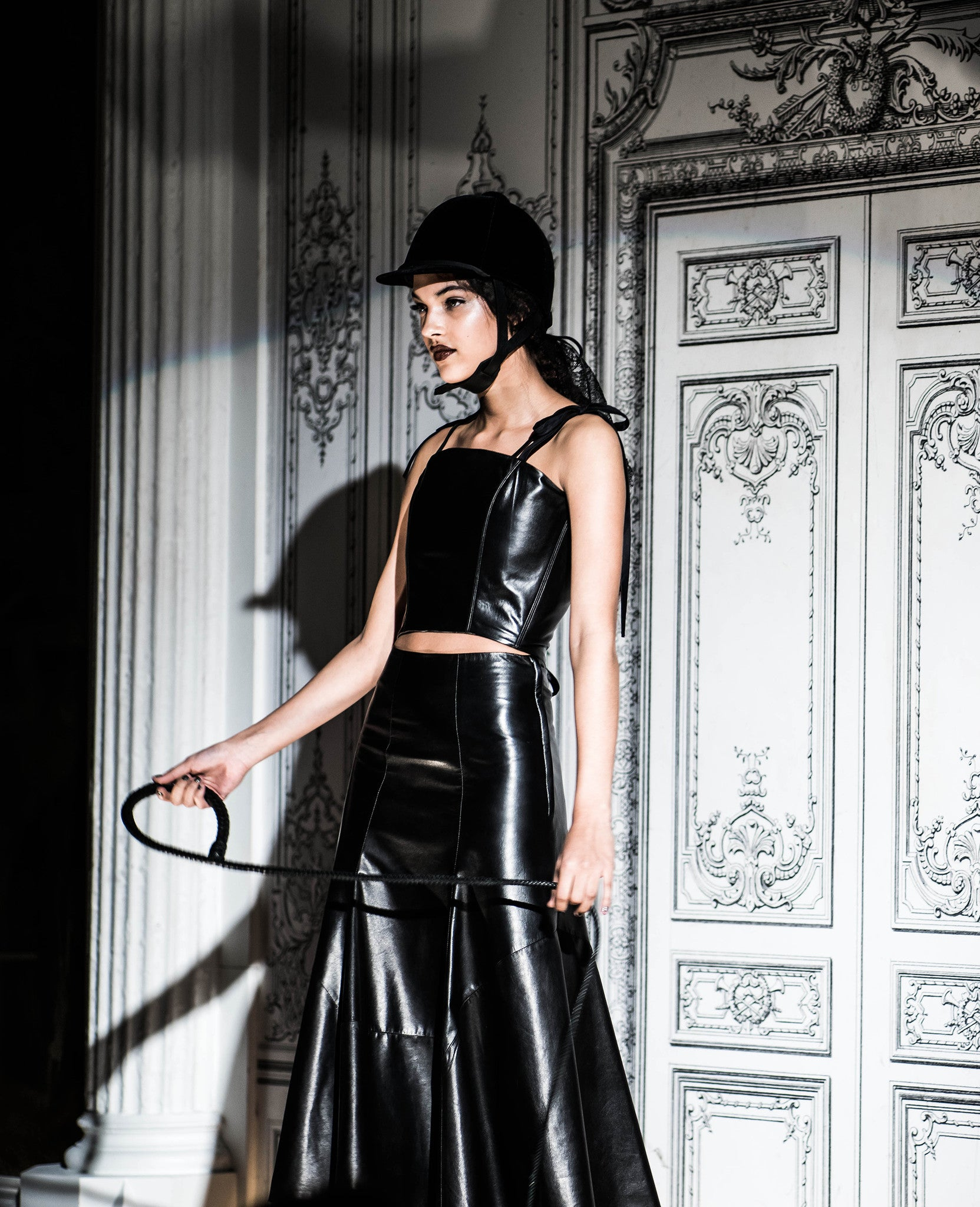 The Rebel Jung Leather Bustier Ribbon Bow Tie Shoulder Straps Lace up Tie back & Leather Skirt Whip Dominatrix Wendy Nichol Clothing Fashion Designer Handmade in NYC AW14 Ready to Wear Fashion Runway Show Custom Tailoring Made to Measure Made to Order Bespoke