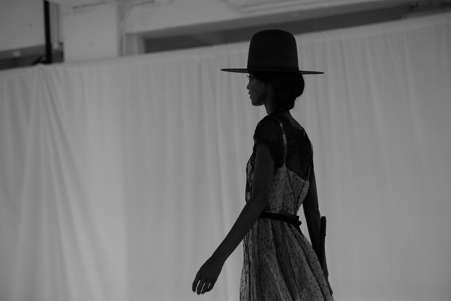 Fatima Siad IMG Model Wendy Nichol Clothing Designer Ready to Wear Fashion Runway Show SS16 Guardians of Light Afternoon Delight French Solstiss Silk Lace Nude Black Cut out should dress Sheer Handmade in NYC Made to Measure Order Custom Tailoring Fabric Color Black Wide Brim Straw Hat Brunette Horse Hair Whip