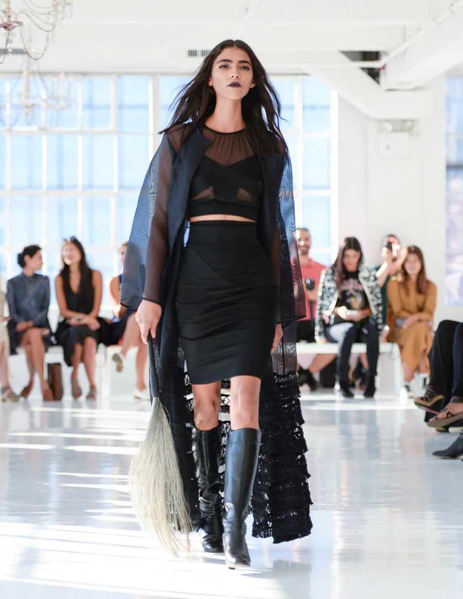 Karina T. IMG Model Wendy Nichol Clothing Designer Ready to wear Fashion Runway Show SS16 Guardians of Light Handmade in NYC Sheer black Silk Organza Fringe Coat Cross Mesh Crop Top Cross Fitted Skirt Horse Hair Whip