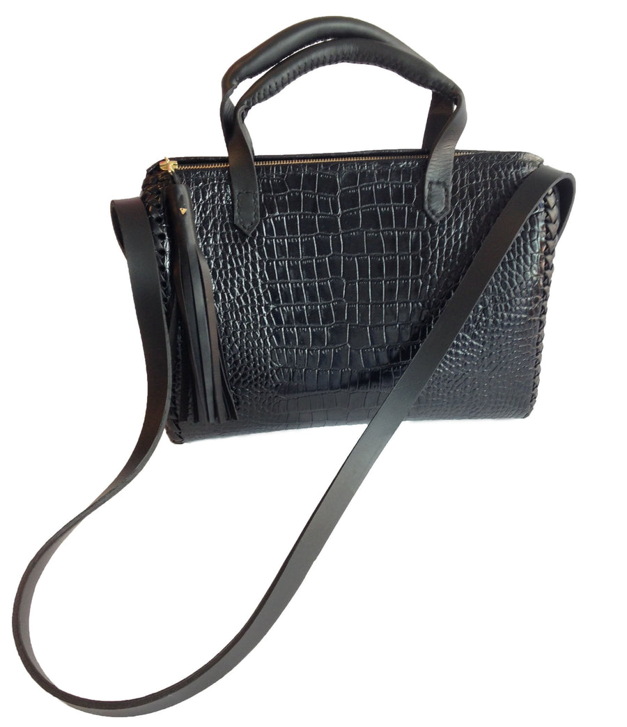 Shiny Black Embossed Croc Crocodile Alligator Cowhide Black Leather Dr Doc Doctor Classic Handbag Bag Wendy Nichol Designer Handbag Handmade in NYC New York City Cross body Strap Detachable adjustable large handles braided structured interior pockets zip zipper large Fringe tassel High Quality Leather