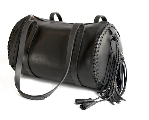 Black Leather Duffle Bag Wendy Nichol Luxury Handbag Designer Luggage Travel Gym Elegant Feminine Fringe Tassel Tassels Zip Zipper Duffel Duffle Round Cylinder Cylindrical Circular Circle Handbag Shoulder Bag Durable handles Handmade in NYC New York City High Quality Black Leather