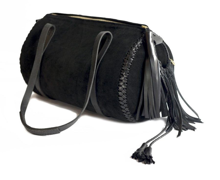 Suede Black Leather Duffle Bag Wendy Nichol Luxury Handbag Designer Luggage Travel Gym Elegant Feminine Fringe Tassel Tassels Zip Zipper Duffel Duffle Round Cylinder Cylindrical Circular Circle Handbag Shoulder Bag Durable handles Handmade in NYC New York City High Quality Black Leather