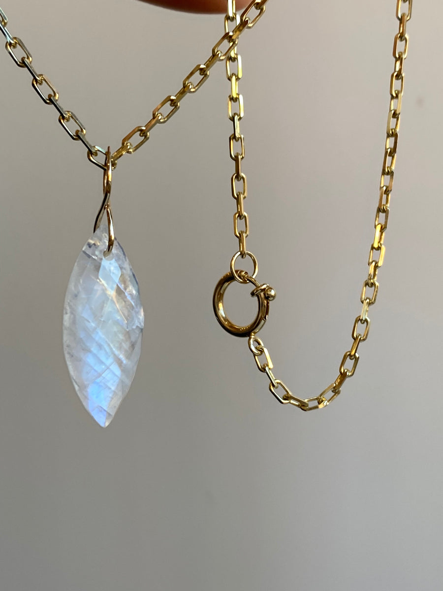 Faceted Marquise Moonstone on a 14k Yellow Gold Infinity Bale