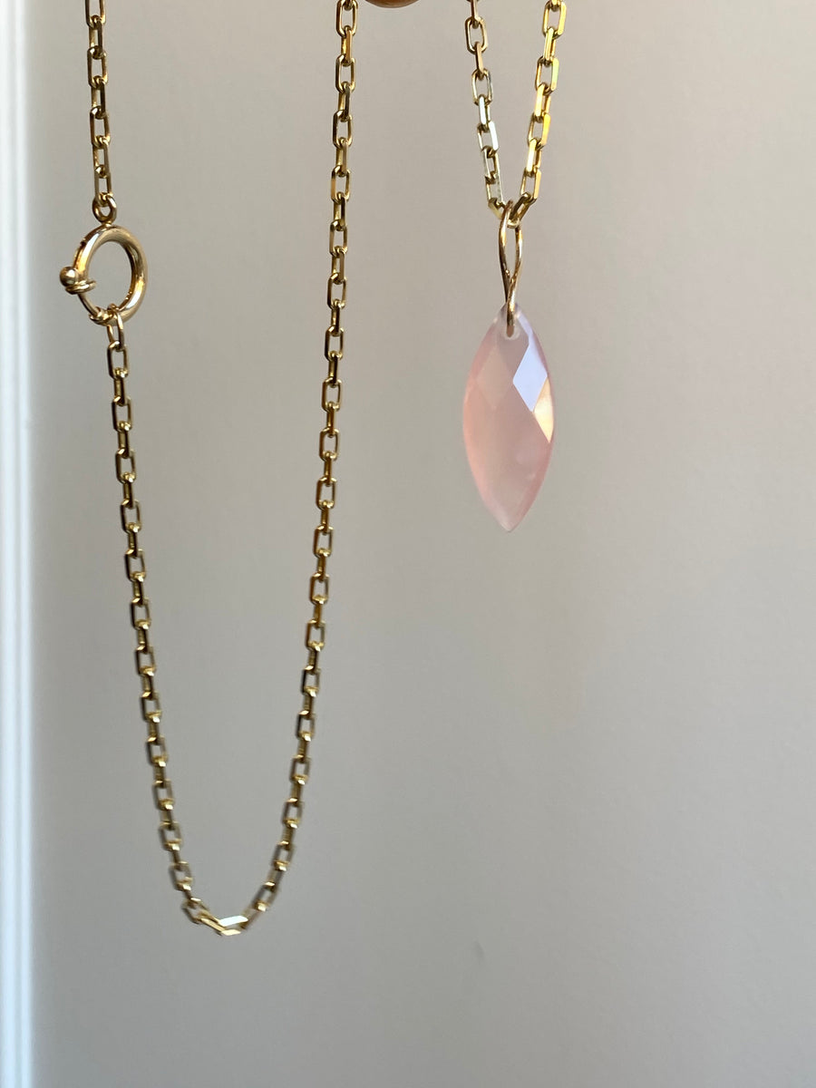 Faceted Marquise Rose Quartz on a 14k yellow gold infinity bale