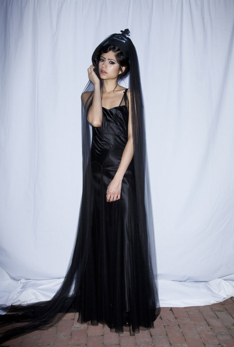 Catalina IMG Model Wendy Nichol Clothing Designer First Fashion Runway Show Saints of the Zodiac Astrological Sign Aquarius Gown Water Bearer Elizabeth Street Sculpture Garden Handmade in NYC New York City Made to Order Made to Measure Custom Tailoring Bespoke Sheer Black Silk Tulle Mesh Net cut out lace deep V plunge neck Dress Gown Silk Satin Slip Dress Sleeveless Ribbon straps Black Veil Leather Crown Gothic Victorian Elizabethan Queen Sea Witch Summer Beach Bride Wedding Black Tie Event