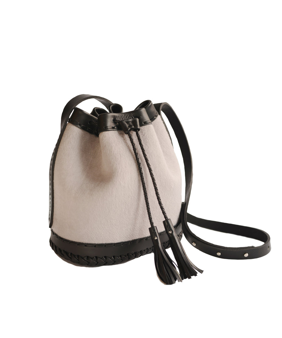 Lavender Gray Grey Light Purple black Leather cowhide Pony Cow Fur Small carriage Bag Wendy Nichol Luxury Handbag purse Designer handmade in NYC New York City bucket Drawstring Draw String Pouch Small fringe tassel Mini cross body adjustable durable strap High Quality Leather