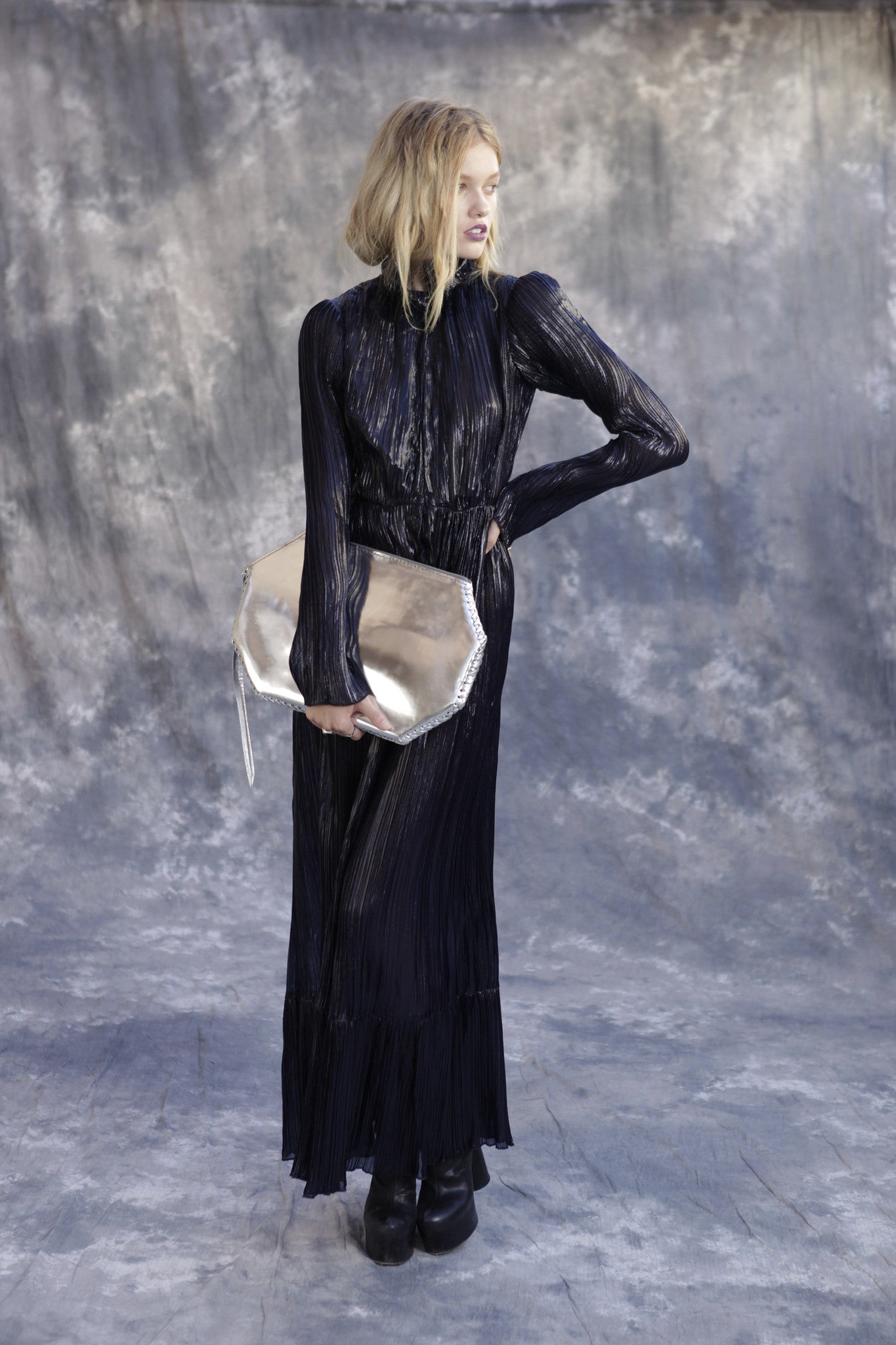 Maggie Laine IMG model Sheer Sparkle Midnight Navy Blue Dress Long Sleeves High Collar Victorian Edwardian Future lines pleated pleats silk Wendy Nichol Clothing Designer SS17 Ready to Wear Fashion Runway Show Death Valley Desert Mirror Patent Metallic Silver Emerald shape Clutch leather bag Handmade in NYC