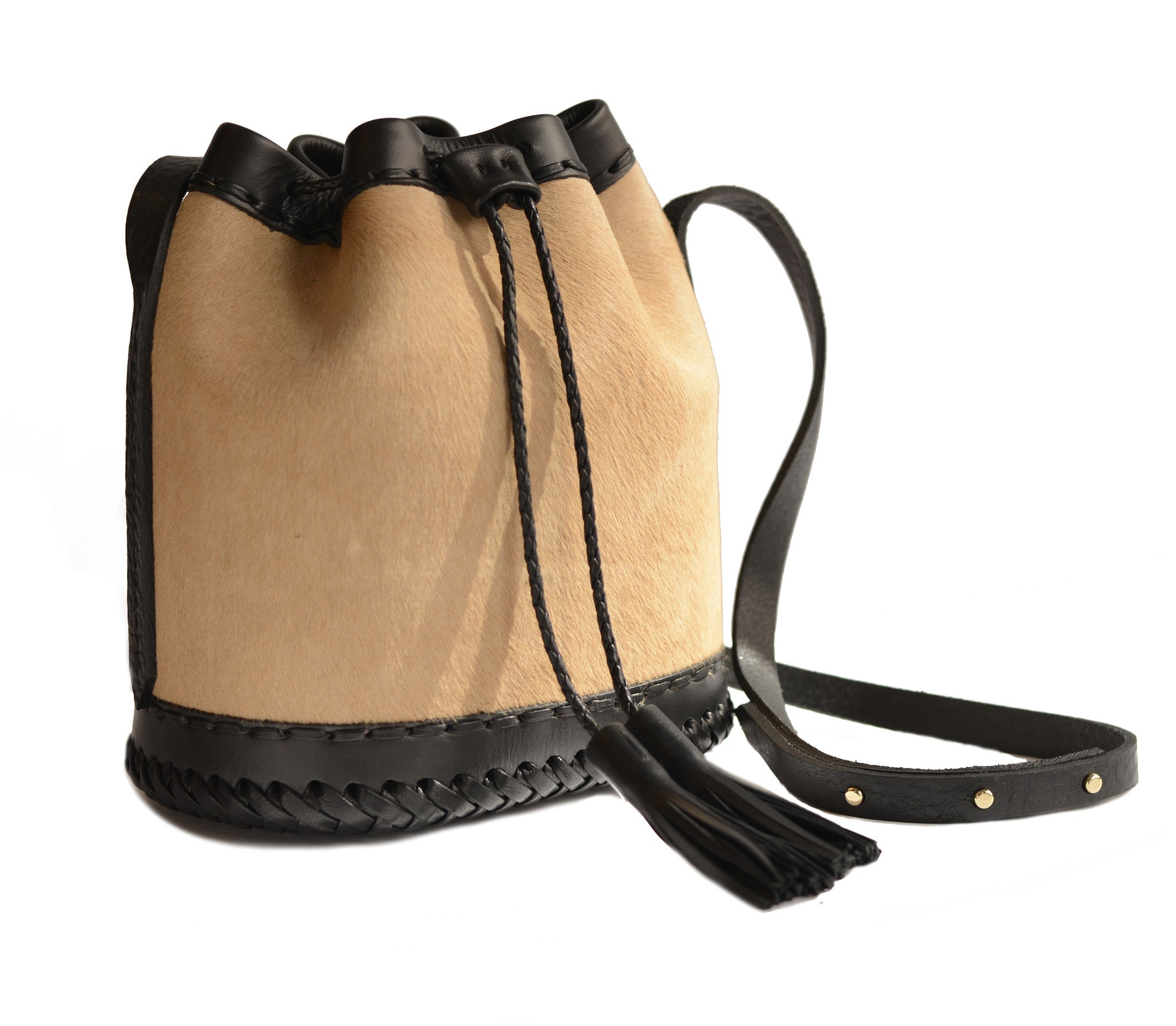 Sand Brown Carmel Tan black Leather cowhide Pony Cow Fur Small carriage Bag Wendy Nichol Luxury Handbag purse Designer handmade in NYC New York City bucket Drawstring Draw String Pouch Small fringe tassel Mini cross body adjustable durable strap High Quality Leather