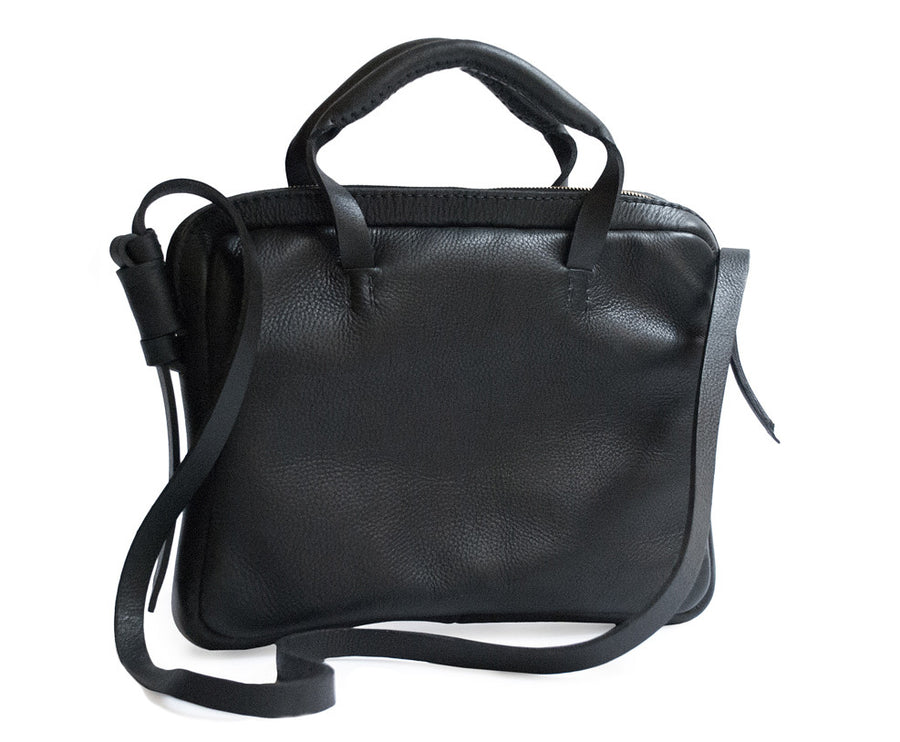 Black Leather Mona Brief Briefcase Bag Wendy Nichol Designer Handbag Purse Handmade in NYC New York City cross body Adjustable strap handles Zip zipper Computer work documents interior pocket hand stitched Briefcase Structured Rectangle Square High Quality Leather