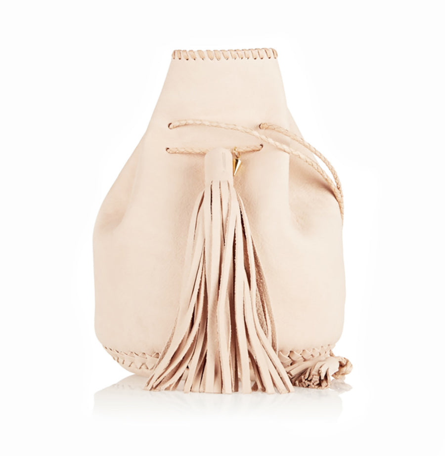 Natural Pink Tan Untanned Leather Whipstitch Bullet Bag Wendy Nichol Designer Purse Handbag Handmade in NYC New York City Leather Fringe Tassel Drawstring Bucket Pouch Boho Handbag