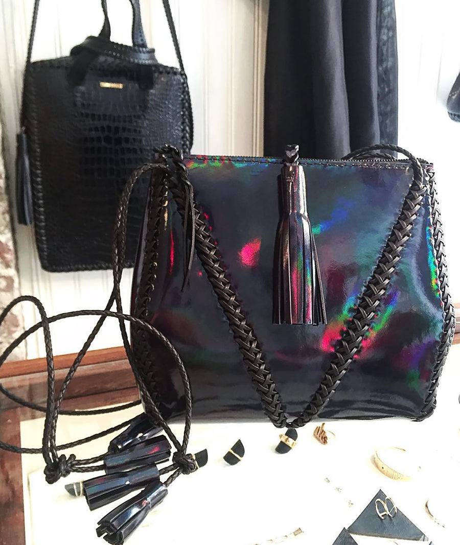 Shiny Reflective Rainbow Black Metallic Patent Braided V Bag with Zipper Leather Cross Body Wendy Nichol Handbag Purse Designer Handmade in NYC New York City high quality Leather cross body zip zipper purse Large Fringe Tassel tassels sculpture braided straps