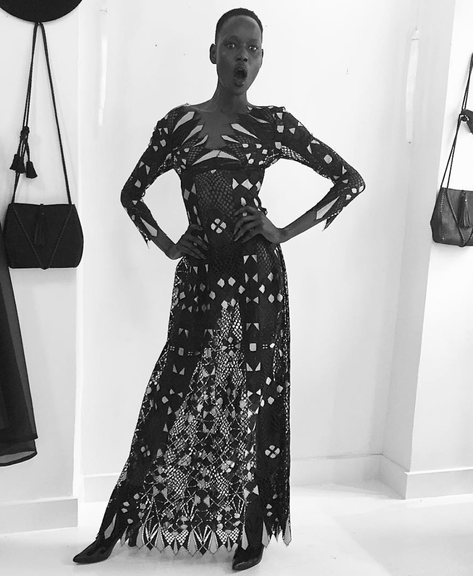 Ajak Deng IMG Model Wendy Nichol Clothing Designer Made to Order Custom Tailoring Made to Measure Handmade in NYC New York City Fashion Runway Show AW16 13 Incarnations Lace Diamond Pattern Dress Sheer Navy Black Gold Gray Grey Long Sleeve Deep V Diamond Triangle Shape Lace Gown Sheer Cut Out
