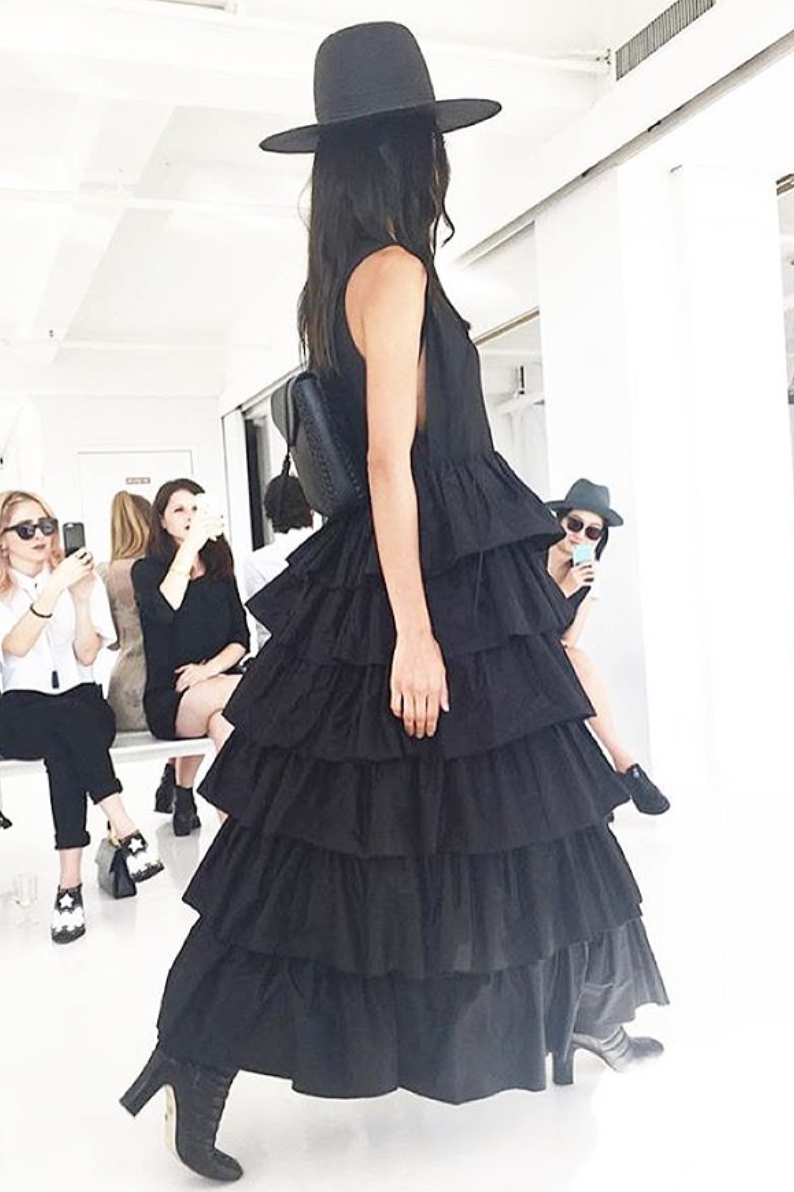 Mini Black Leather Backpack Monic IMG Model Wendy Nichol Clothing Designer Ready to Wear Fashion Runway Show SS16 Guardians of Light Dusk Ruffle Dress Modern Sleeveless Silk Layered Ruffles Handmade in NYC Black Straw Wide Brim Hat