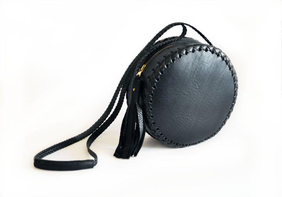 Small Black Leather Canteen Bag Wendy Nichol Handbag Purse Designer Handmade in NYC New York City Braided x Round Circle Cross body Adjustable Strap Zip Zipper Large Fringe Tassel High Quality Leather Braided Strap