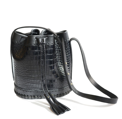 Black Shiny Reflective Embossed Croc Crocodile Alligator Cowhide Leather Small Carriage Bag Wendy Nichol Handbag Purse Designer Handmade in NYC New York City Bucket Bag Drawstring Draw string Pouch small fringe tassel Adjustable Durable Strap High Quality Leather