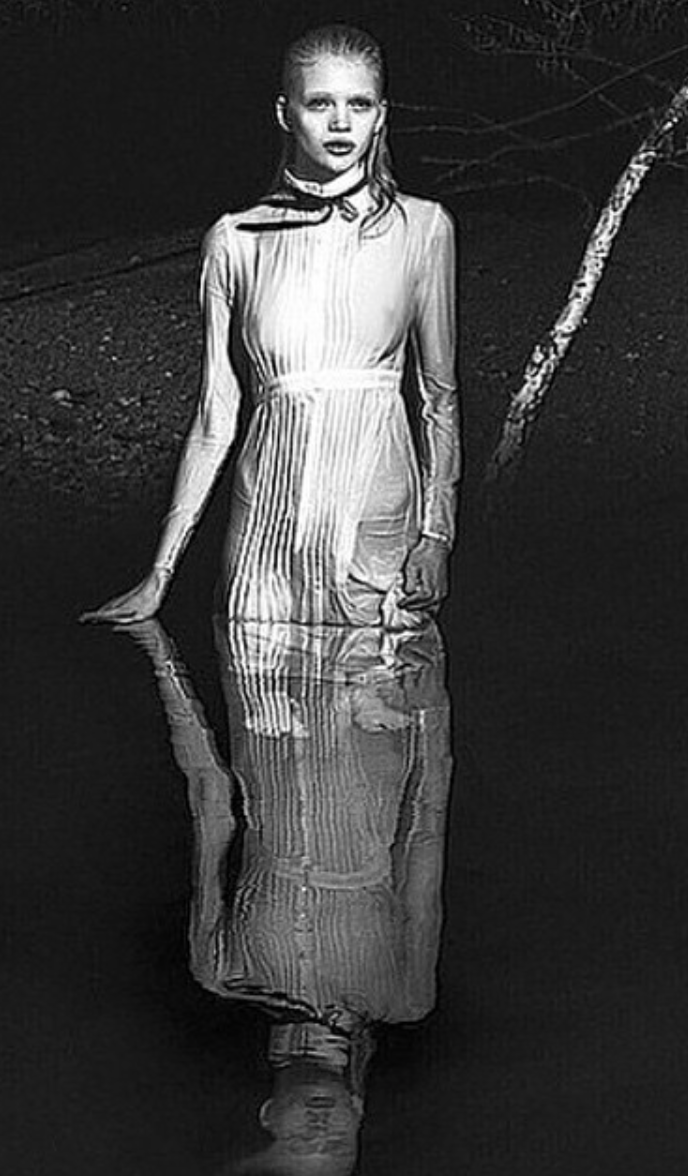 W Magazine Wendy Nichol Water White Silk Cotton Victorian Teacher Dress with Black Lace Trim black Bow Wendy Nichol Clothing Designer Fashion Runway show SS15 Space Master handmade in NYC New York City Bespoke Made to Order Made to Measure custom tailoring Sheer Transparent Fall Summer Spring Long Sleeve High collar Victorian Edwardian button up blouse Teacher dress floor length Black French lace trim Goth Gothic