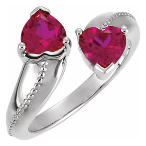 Two Hearts that beat as one!  This ring symbolizes meaning of love with two heart shaped Lab-Created Ruby Stones.  The brilliant ruby stones are set on a 14k polished white gold band.   What is so unique about the design are the heart shaped stone.  What