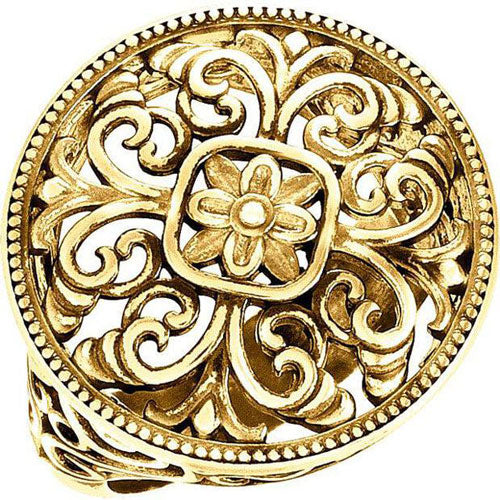 a gold antique-inspired filigree ring