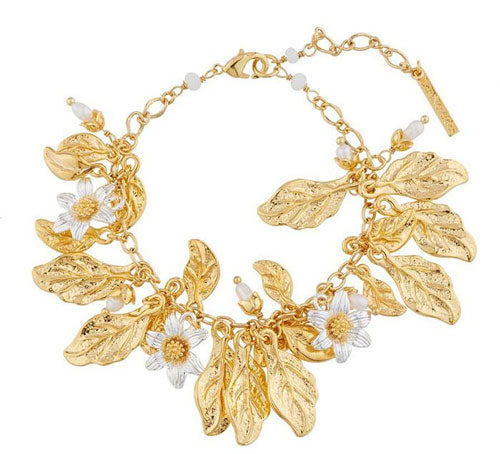 a charm bracelet with gold leaves and flowers