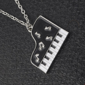 Necklace- Rhinestone black and white piano pendant long chain crystal music jewelry