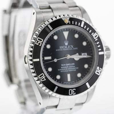 40mm Pre-Owned Rolex Sea-Dweller SS Black Dial Black Bezel Oyster Band