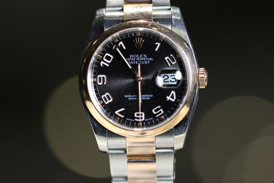 36mm Pre-Owned Rolex Datejust Two-Tone 18R & SS Black Dial Oyster Band