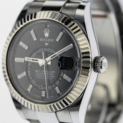 42mm Pre-Owned Rolex Sky-Dweller SS Black Dial with Chromalight Display 18W Fluted Bezel Oyster Band