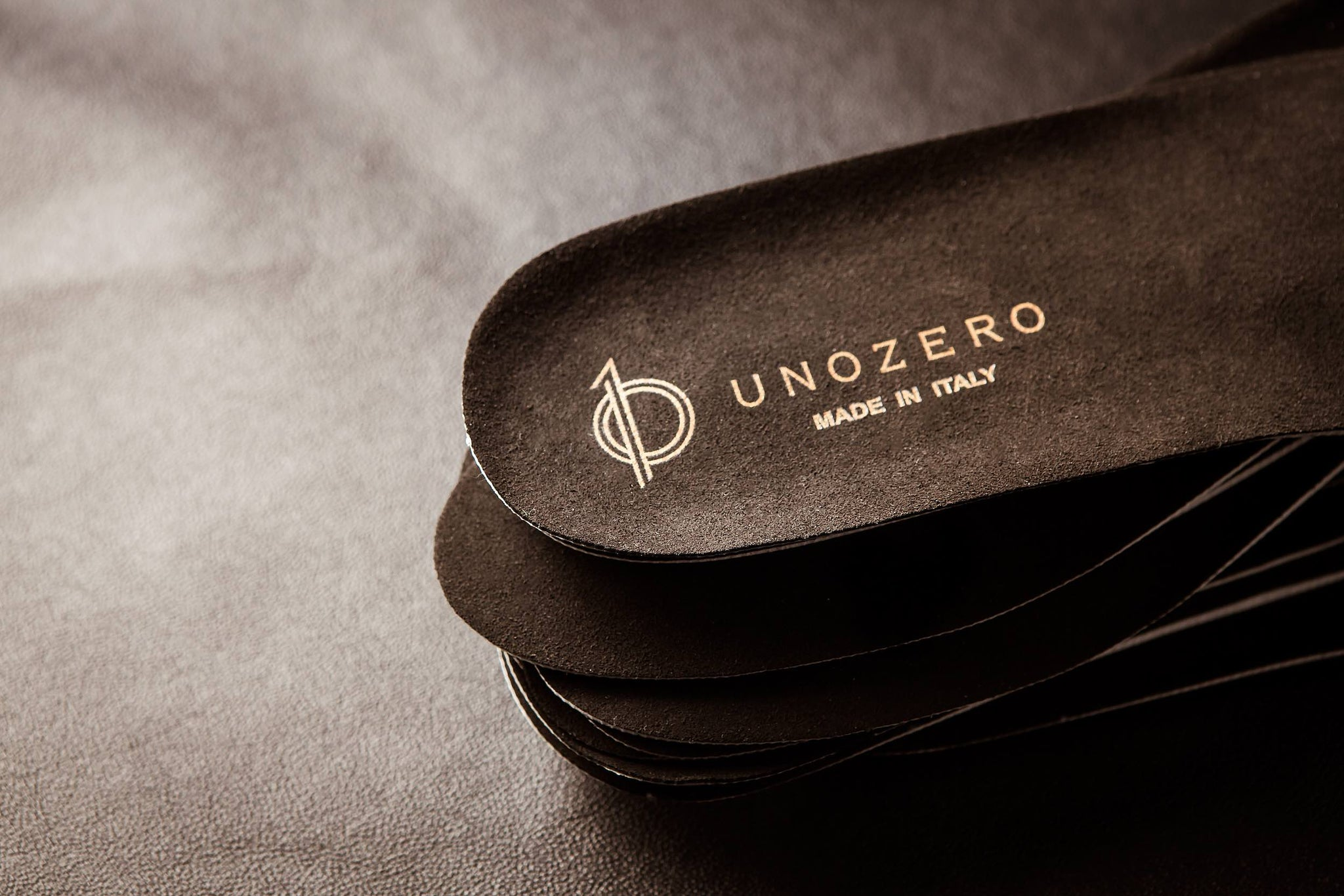 Shoe sole with UNOZERO logo