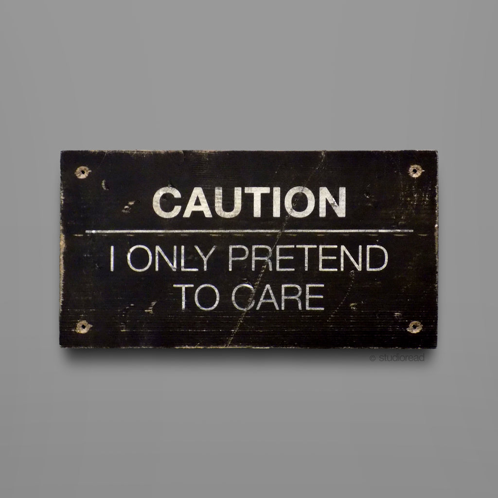 I only pretend to care - Sign