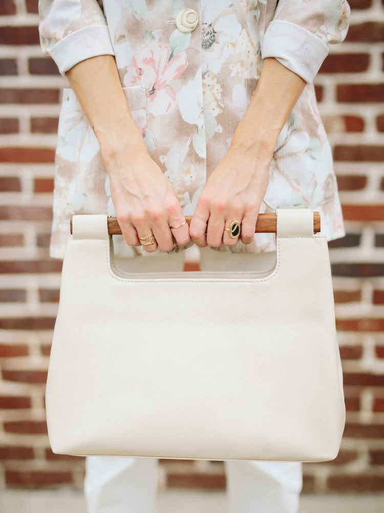 Italian Leather Tote Handbag- model holding Wood cut out white Tote Handbag by Payton James