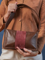 Model holding Baby Spice Leather shoulder tote handbag- Espresso and Cabernet Color-by-PaytonJames-Nashville-designer