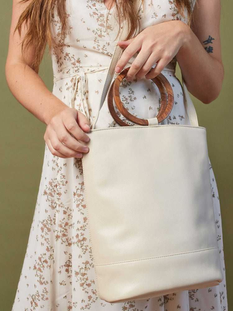 White Leather Tote and Crossbody Handbag by Payton James: Nashville Handbag Designer model holding bag