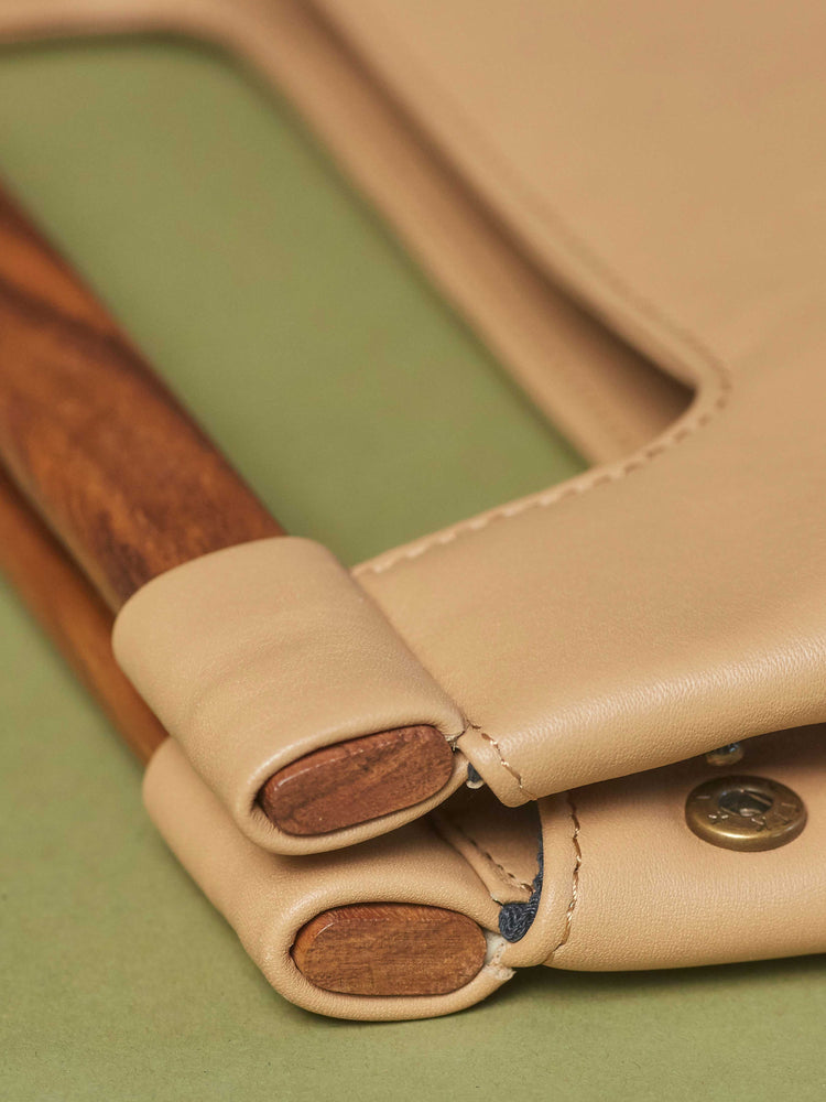 Leather-Tote-Handbag-Wood-Cut-Out-Tote-by-Payton-James-Cappucino-Tan-Color closeup of wood handle