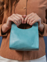 Leather-Crossbody Handbag- Emerald Color-by-PaytonJames-Nashville-designer. model holding bag