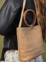 Leather-Tote and Crossbody-Handbag-Cappucino-Bag-by-PaytonJames-Nashville-designer bag on the back of model