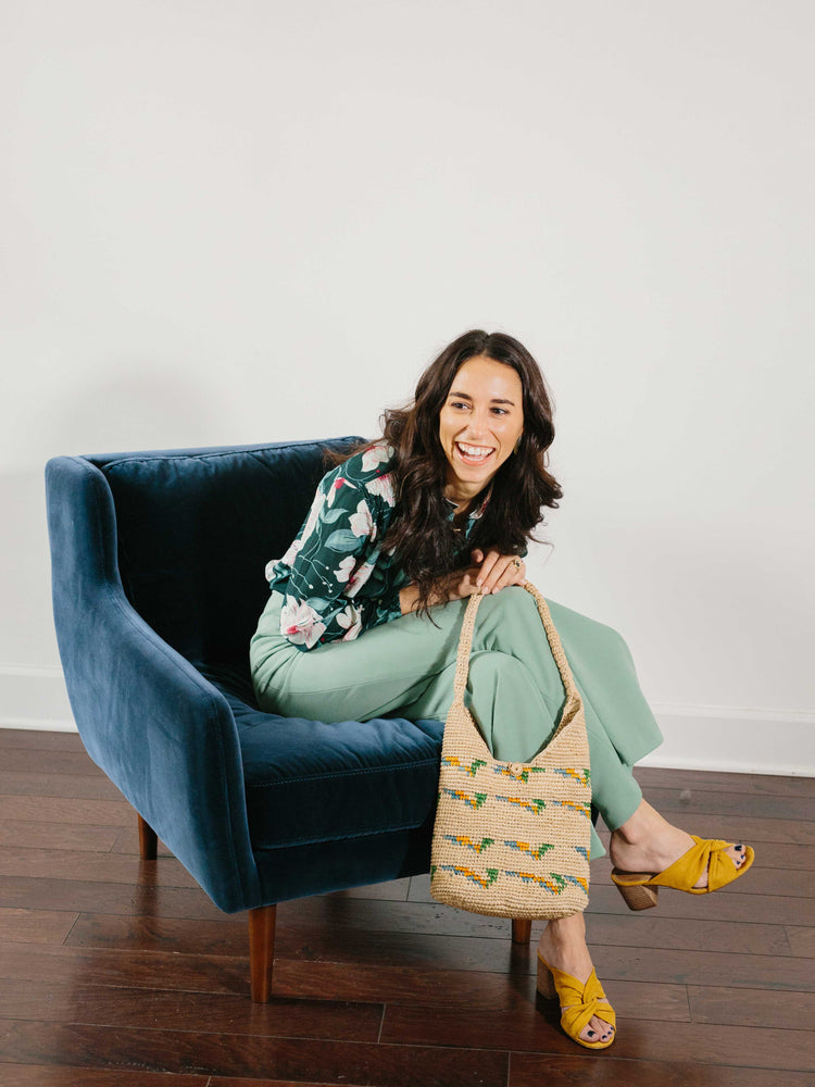 Straw Hobo Bag with smiling model by Payton James Nashville Handbag designer