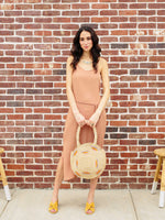 Straw Bag-Raffia Round Circle Bag held by model by Payton James Nashville Handbag designer