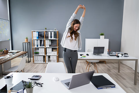 Woman standing up and stretching