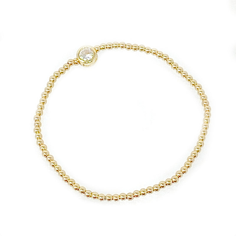 Mini Gold Ball Bracelet with Bezel Set Stone