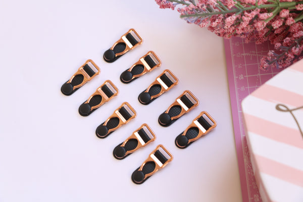 Rose Gold and Black Metal Suspender Clips