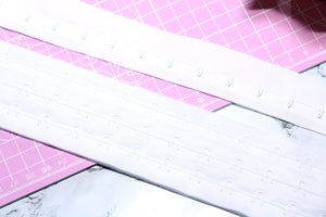 white continuous hook and eye tape. white corsetry tape